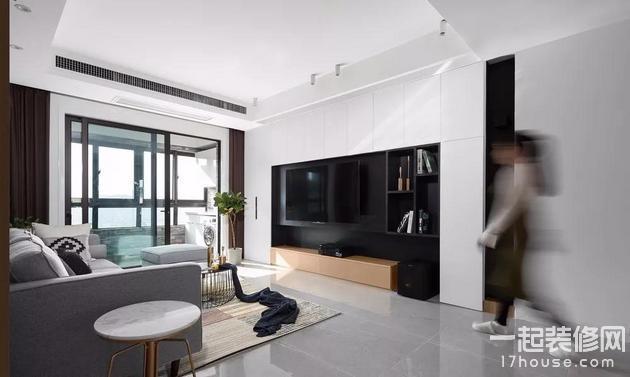 电视背景墙采用造型柜的设计,木色的加入减少了白色与黑色的强烈对比